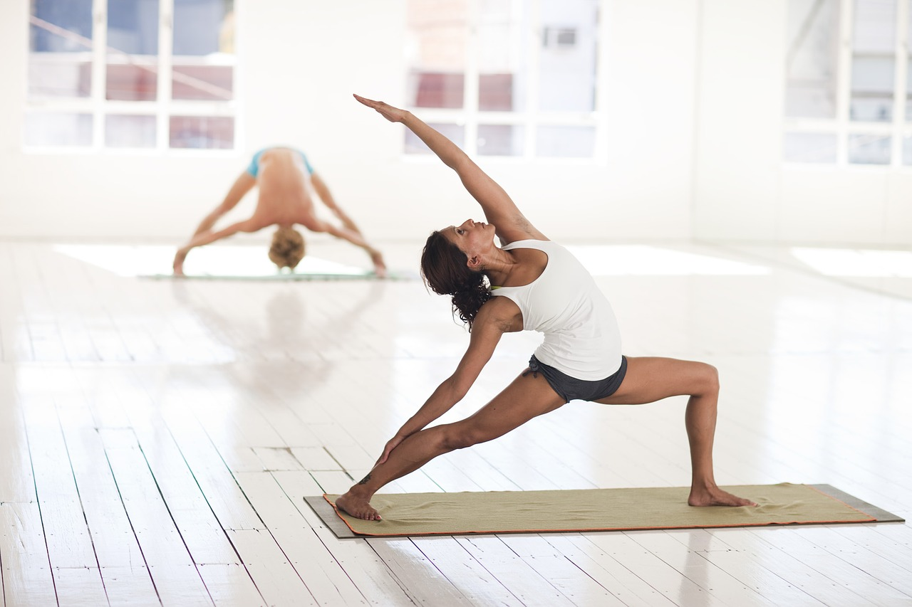 a woman does hot yoga